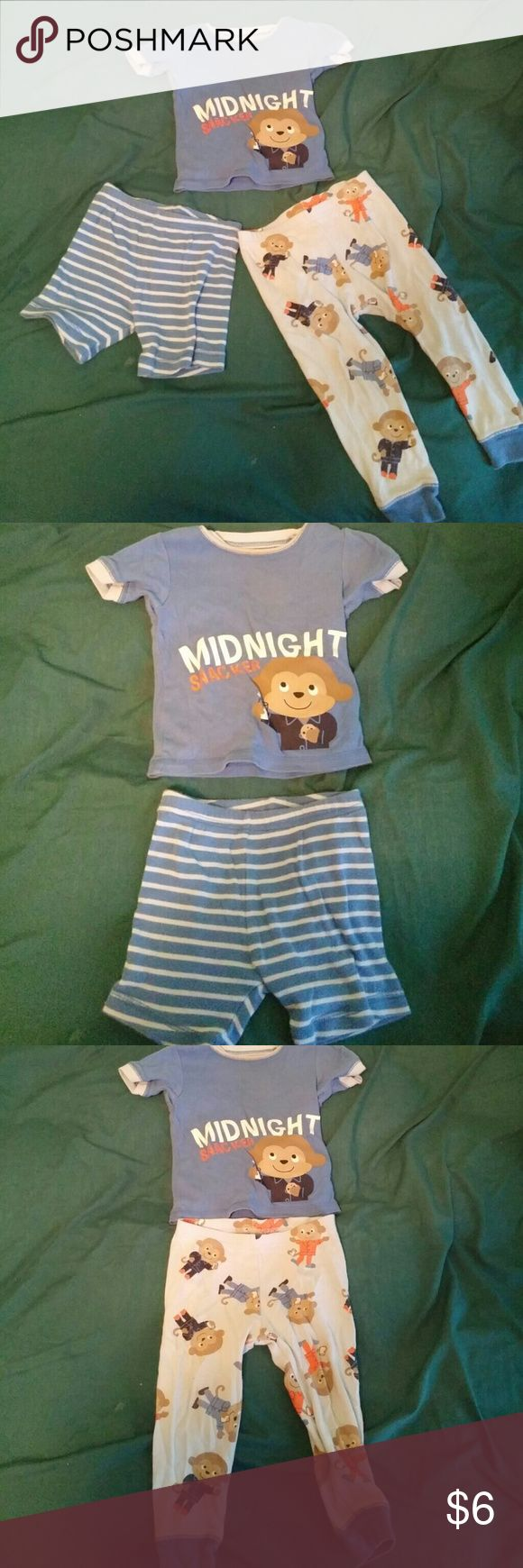"3 piece pajama set This is a three piece pajama set. It has one top that says ""Midnight Snacker"" with a monkey holding a glass of milk and a cookie. There are two bottoms to this set. A pair of shorts with blue and light blue stripes. A pair of pants that are light blue with monkeys wearing pajamas and holding glasses of milk. Carter's Pajamas Pajama Sets"