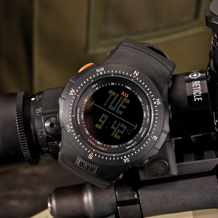 5.11 Tactical Series. Includes compass and elevation functions. Used this watch through 2 deployments. Buy extra bands though, they will brake after a lot of use, but are easy to replace.