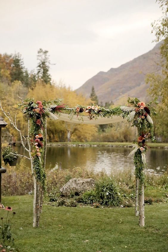 rustic fall floral wedding arch / http://www.himisspuff.com/fall-wedding-arch-and-altar-ideas/5/