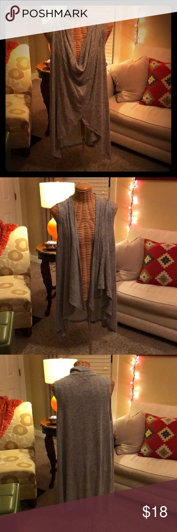 Wrap Sweater Vest Buttons on shoulders allow for multiple ways to wear this cute little number. 😁 Olivia Sky Sweaters
