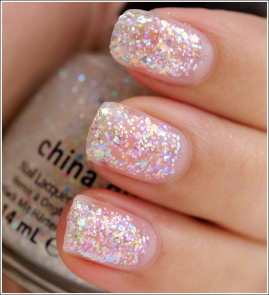 China Glaze Snow Globe (Let It Snow Collection) -- I'm currently wearing this over a pearly white. looks awesome :]]]]