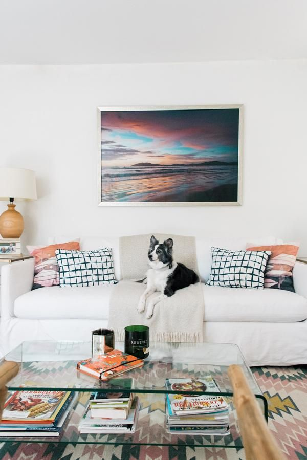 Sunset Print Above White Sofa With A Lulu And Georgia Rug In A