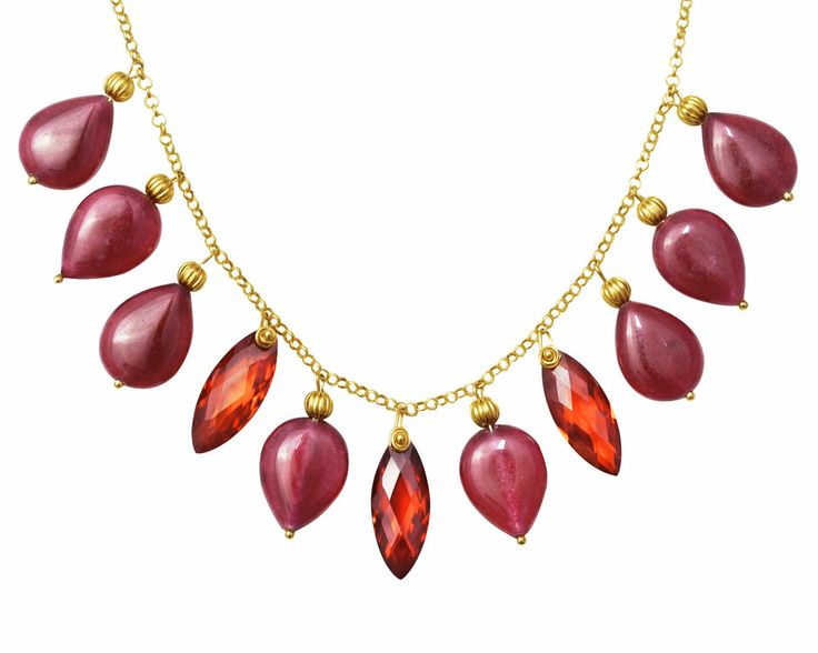 The necklace is made with Jade dyed Garnet and red Cubic Zirconia. The gems are sustained by a gold-plated Sterling Silver 925% chain, with golden elements. The Jade Garnet beads have a teardrop shape and they measure 16x12mm. The intense red color of Cubic Zirconia will leave you speechless, faceted marquise cut, size 20x8mm. The Jade Garnet necklace has a length of 53cm and a gold plated Sterling Silver 925% lobster clasp, adjustable size.