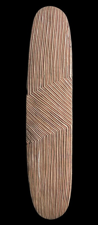 A Wunda Shield, Western Australia   carved hardwood, natural earth pigments  Length: 80.5cm