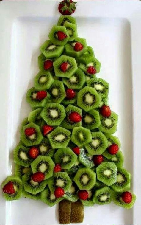 Christmas tree fruit plate perfect for Christmas breakfast or your holiday party appetizer table. Healthy Christmas holiday snack ideas for your party.