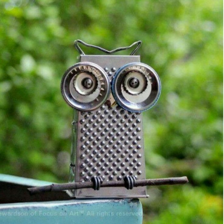 Recycling: Cheese grater owl.  No tutorial, just a picture.  Eyes: Bottle caps, lids & bolts. Feet: springs wrapped around a branch. Beak:  looks like a calligraphy tip.