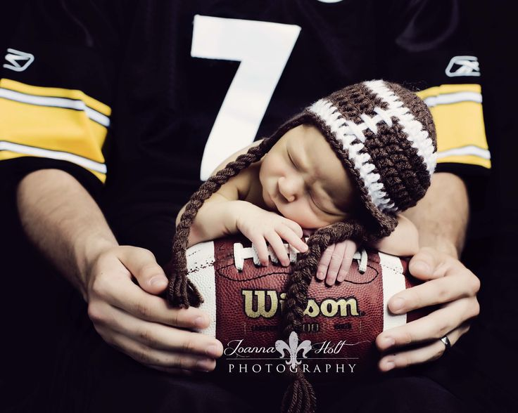 Newborn football pose with Daddy :) My kids will be born HOG Fans!