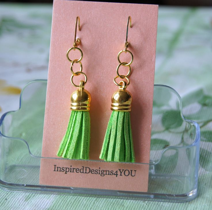 "Boho earrings, fresh lime green...""Spring time in Ireland"".......step lively bringing fun into your heart.   https://www.etsy.com/listing/161398965/neon-lime-faux-leather-tassel-capped?ref=shop_home_active_9"
