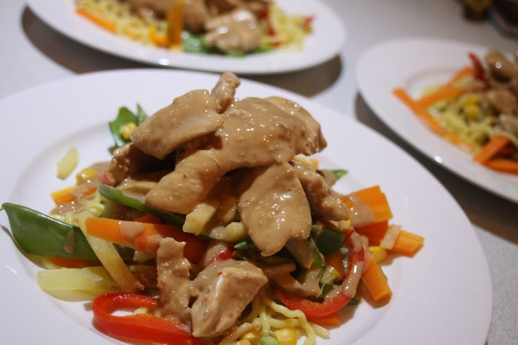 Warm chicken noodle salad with satay sauce