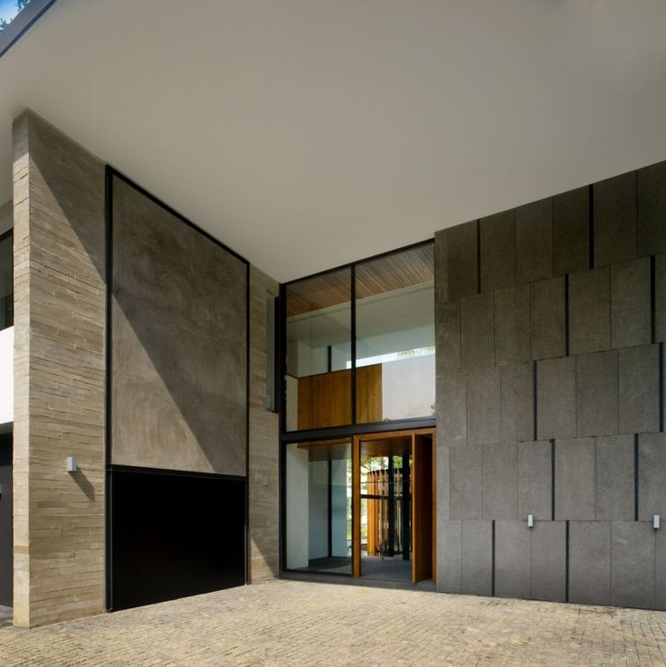 The Screen House, Combines Landscape And Building Design To Maximize  Function : Front View With Natural Stone Wall Exte.