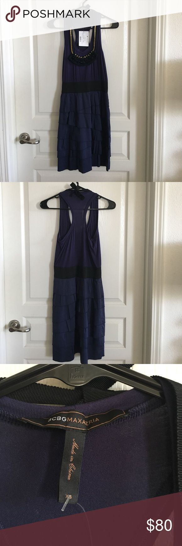 """NWT BCBG Tiered Ruffle Dress with Necklace Sz XS Brand new and never worn. Tiered Ruffle dress with elastic waistband. Top is a racer back tank. Comes with an attached necklace. Color is deep blue and black. Lined. Cotton/spandex/rayon. Length is 36"""". Waist is 12"""" unstretched. One piece of the necklace is a little bent and not perfectly round (see last pic). However, it is only noticeable when you look closely. Also, necklace is sewn on and left side has come off. Should be easy fix to…"""