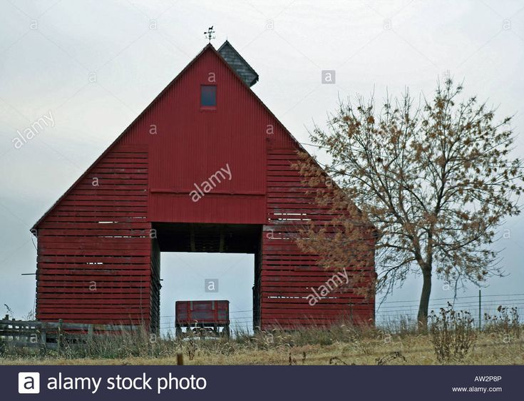 Red Corn Crib Barn On Fall Day Sheltering An Old Wagon With Tree .