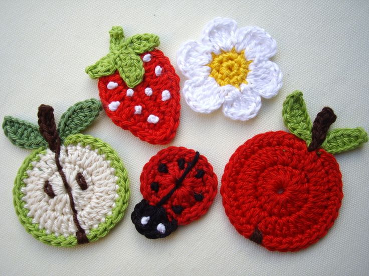 Mixed Crocheted Applique fruits, flowers ,lady bug= i think these would look good on tea towels or napkins, or if you sew on childrens/baby clothing