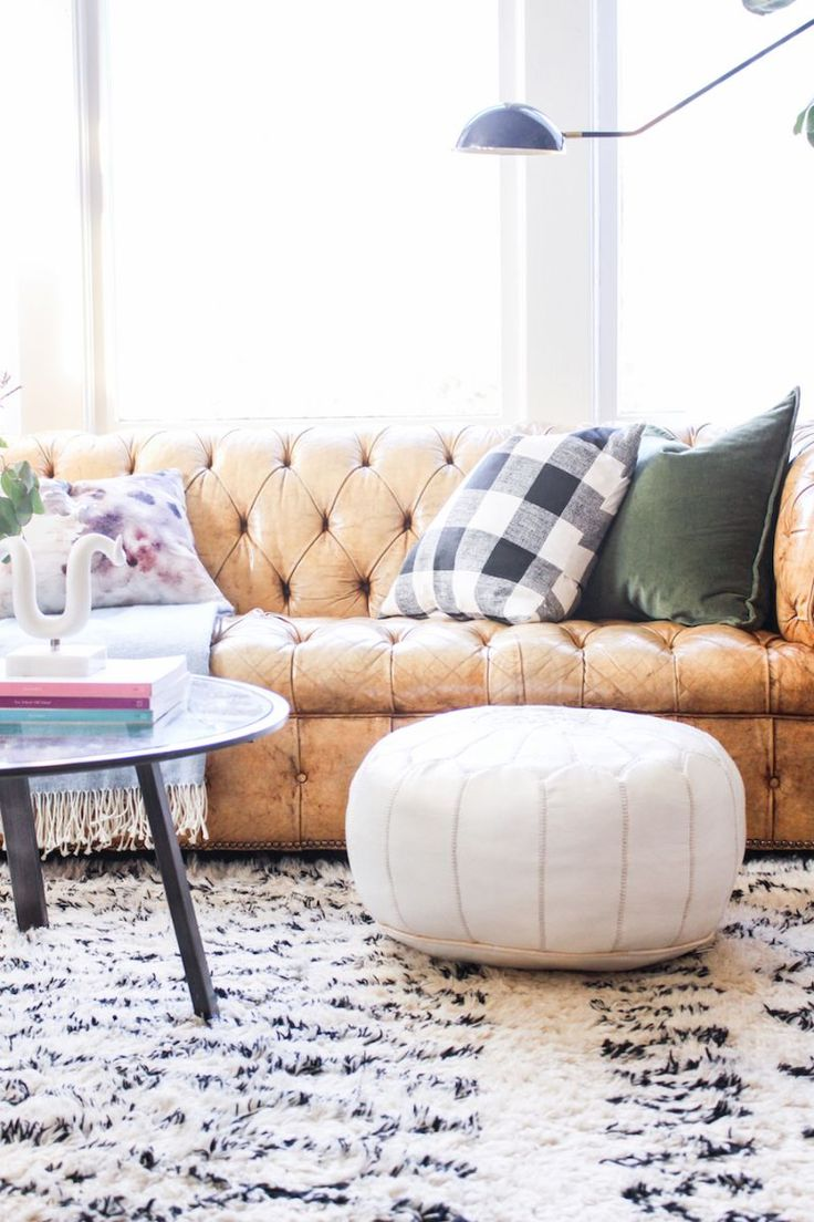 leather tufted sofa, moroccan rug, white ottoman, buffalo check pillow