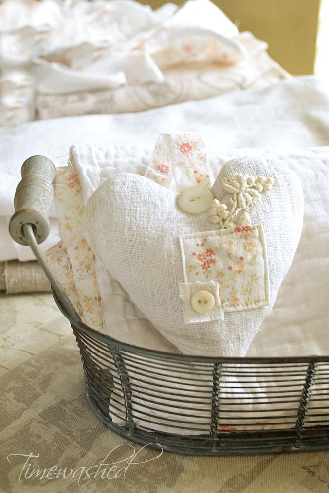Patchwork Heart - this was made using vintage French linen pieces, with the button covering a patch - via TIMEWASHED