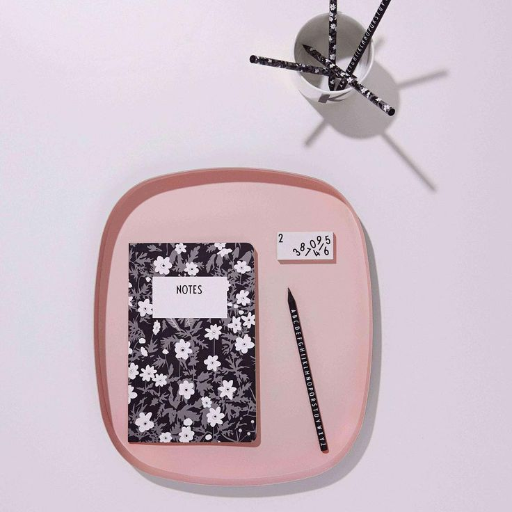 Match made in heaven: Flowers and typography by Arne Jacobsen. Notebook, black pencil, eraser, pink tray and porcelain cup.