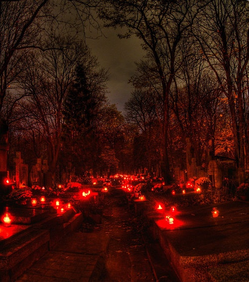 All Souls Day- November 2nd. European cemetery blaze with candles on the graves of the dearly departed