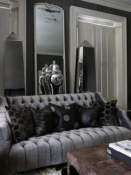 Andrew Martin Black Pillows On Grey Sofa In Dark Interior