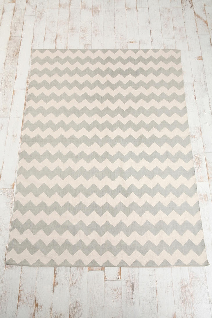chevron rug from urban outfitters.  74.00 for a 5x7.  comes in multiple colors.
