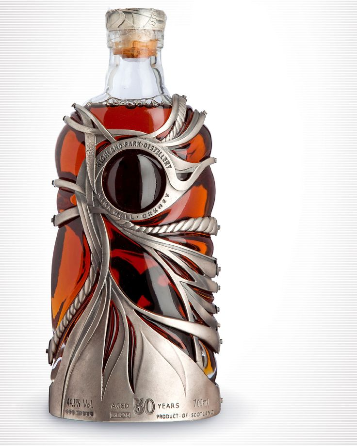 Highland Park 50 Year Old Whiskey - The outer casing, designed to resemble a net, is hand crafted from solid sterling silver with an amulet at the heart of the bottle made from Orcadian sandstone and containing the Highland Park logo.