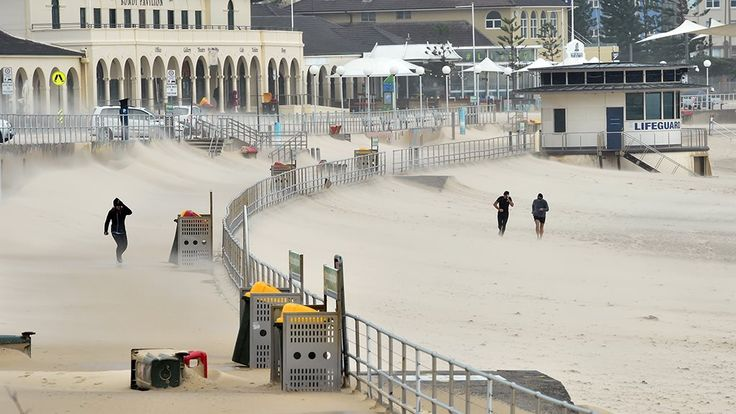 The promenade at Bondi covered in sand blown in by the cyclonic winds
