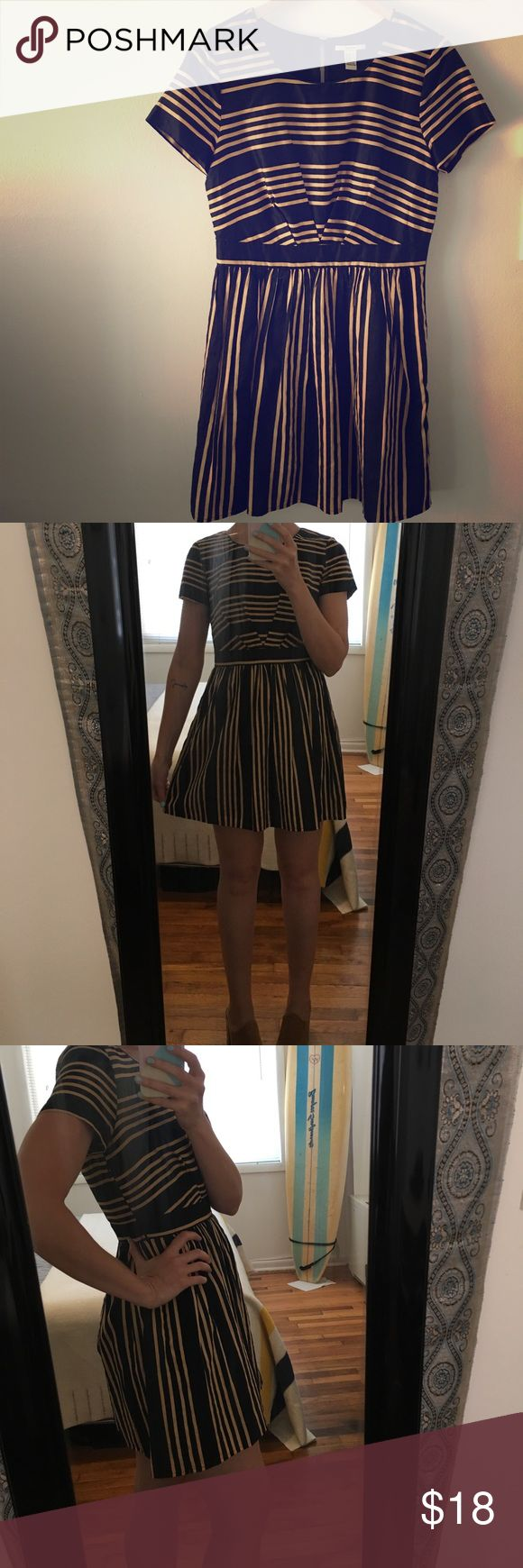 "Retro-style striped cocktail dress Invoke your inner Betty Draper in this super cute mod mini dress. Measures 33.5"" from shoulder to hem. Fully lined. Outer layer 100% cotton, lining 100% polyester. Forever 21 Dresses"
