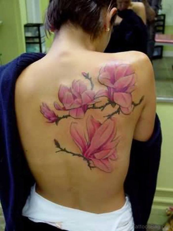 Another Pink. This back magnolia flower tattoo is inspiration.