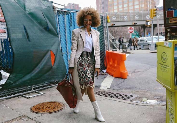 Elaine Welteroth in a Tory Burch top and skirt with a Gucci bag