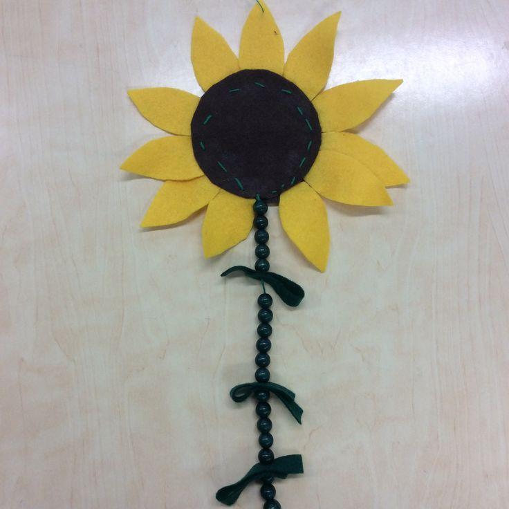 Auringonkukka, huopa ja helmet