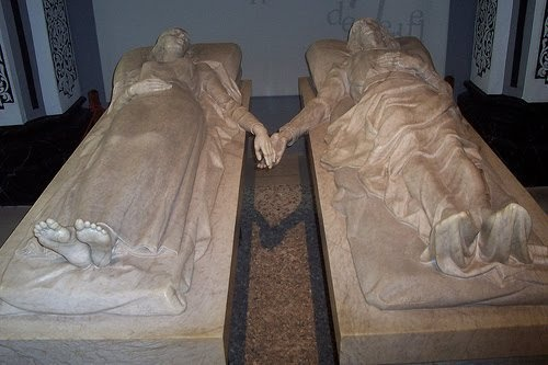 I didn't know where to pin this. It's not a subject one can post on their happy boards.  But what a beautiful way to make a statement of love than to be entombed with the love of your life, holding hands throughout eternity......