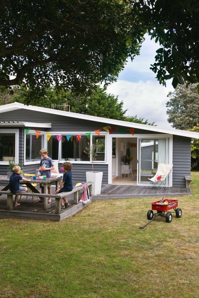 Laid-back Waikanae bach - NZ House & Garden. Rear deck and kitchen servery window.