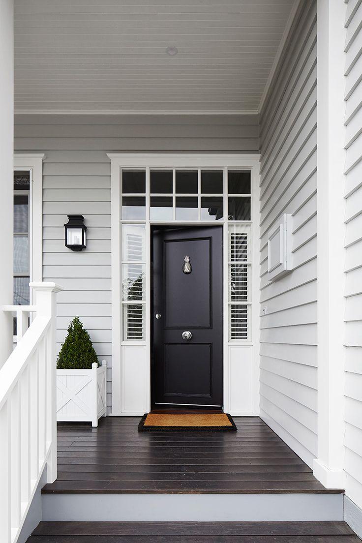 Light Grey Siding White Trim Around Windows And Front Door Black Front Door Dark Hardwood Floors Whit Gray House Exterior Facade House House Paint Exterior