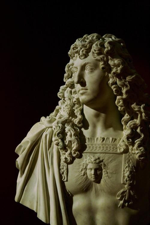 Marble Bust of Louis XIV in Roman armor with a relief of Apollo, representing the Sun King. 1666