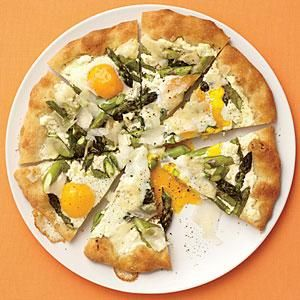 Asparagus, Ricotta and Egg Pizza. Arranging the dough on a hot pizza stone or skillet will get the crust nice and crisp. Keep an eye on the pizza after you add the eggs so they don't overcook.