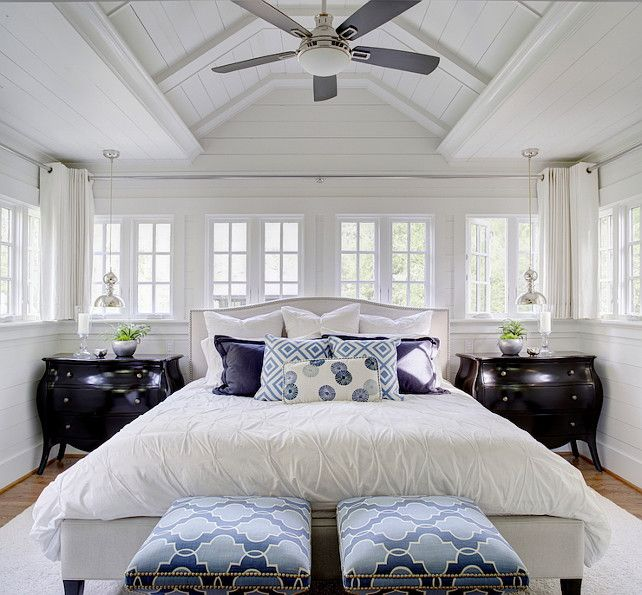 White Bedroom With Bed In Front Of Window Beautiful Bedroom Features A Paneled Vaulted Ceiling Accented With A Ceiling Fan Over A Crate Barrel Colette