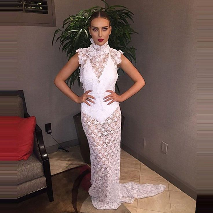 Perrie Edwards posted this photo of her in an elegant, bridal-style dress just one day after news broke that her engagement to Zayn Malik had ended.