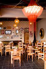 Attic Restaurant, Pankhurst, Johannesburg  A large red 'Flower of life' Chandelier in a popular busy Johannesburg restaurant.