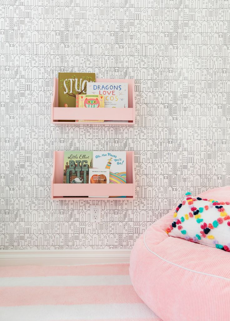 Playroom Reading Nook - loving the pink shelves + decor!