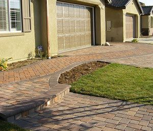 10 Front Walkways For Maximum Curb Appeal: Front Walkway Ideas: Draw a Path Through the Driveway With Pavers