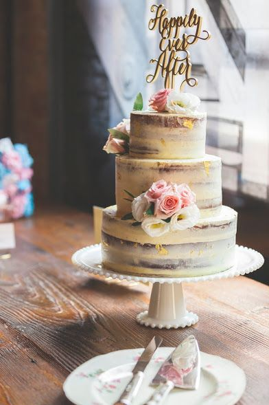 Gold Flaked Naked Wedding Cake for Kayla & Konstantin's Wedding at Archeo in The Distillery District, Toronto. A vanilla buttermilk cake with coffee cardamom filling and vanilla white chocolate buttercream. Flowers by Blush & Bloom (http://www.blushandbloom.ca/) and Photography by CMT Photography (http://christophermtaylor.com/) Cake by us (www.agouti.ca)