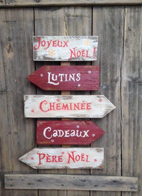 Un panneau de direction à fabriquer avec des planches de palettes et à placer à l'extérieur pour décorer à l'occasion des fêtes de Noël