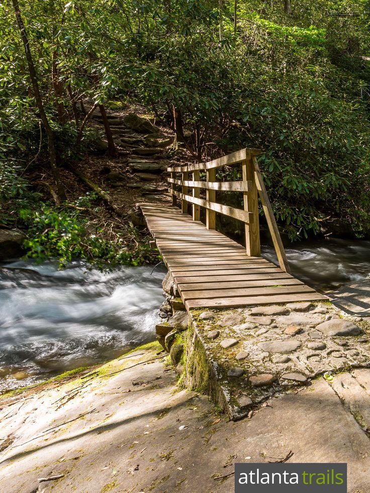Hike the Hemlock Falls Trail across a rustic bridge over Moccasin Creek on the way to Hemlock Falls, one of Georgia's most beautiful waterfalls
