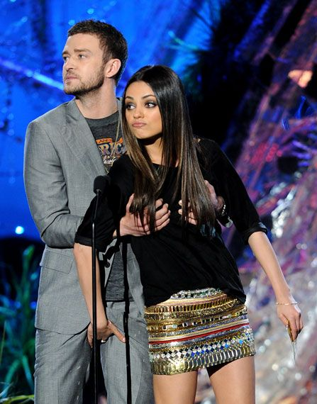 """Best Kiss nominee (""""Black Swan"""") Mila Kunis hands it right back to """"Friends With Benefits"""" co-star and Best Line From A Movie nominee (""""The Social Network"""") Justin Timberlake while presenting Best Male Performance at the 2011 MTV Movie Awards in Los Angeles. from Justin Timberlake"""