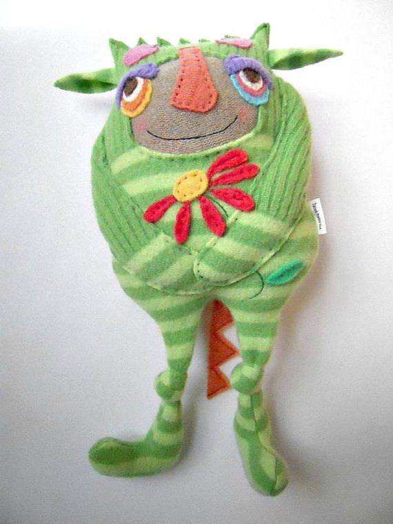 Monster idea. Great face with undersewn face. Knotted knees and sewn down arms...cute, knotted knees/ joints