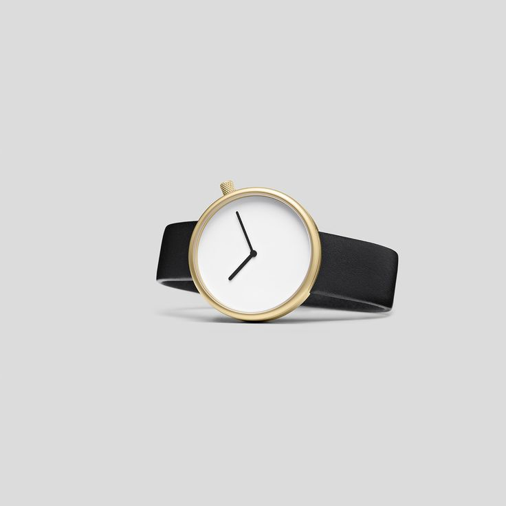 MATTE, GOLDEN STEEL ON BLACK, ITALIAN LEATHER.  Following the slightly asymmetric Pebble and the clean and contemporary Facette, the circular, minimalist Ore watch reduces timekeeping to its pure essence.