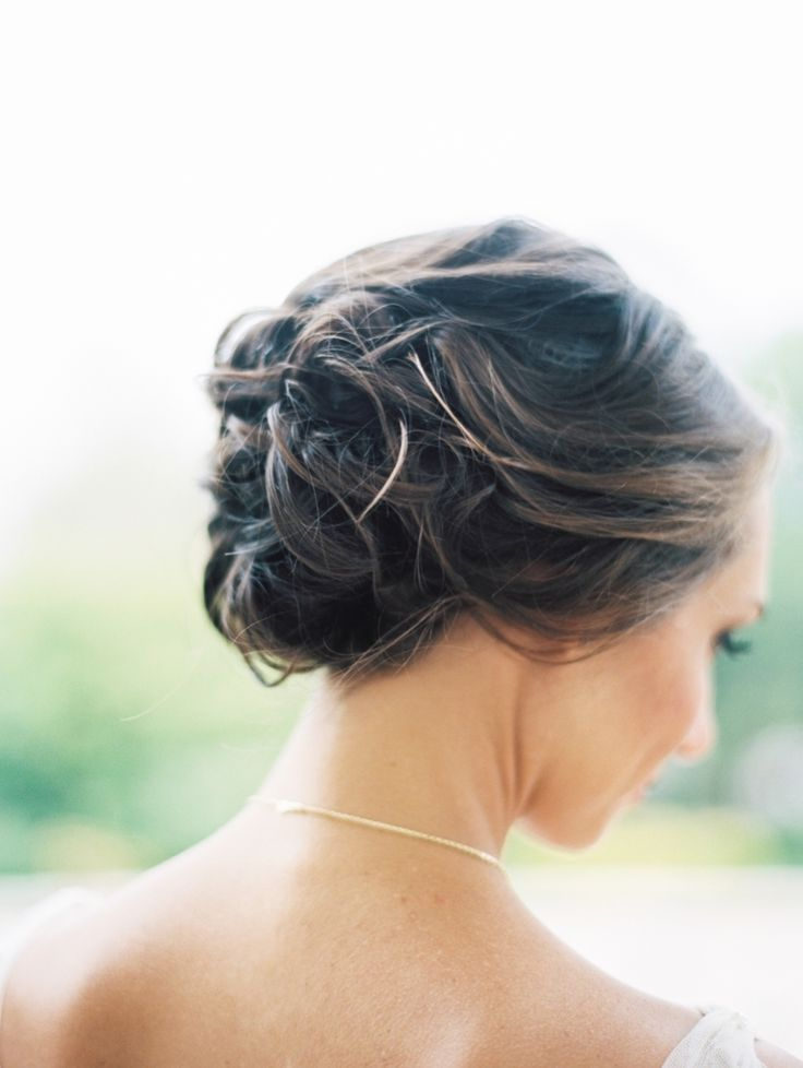Pretty pinned updo: http://www.stylemepretty.com/living/2016/06/23/28-ways-to-style-messy-summer-hair-beautifully/