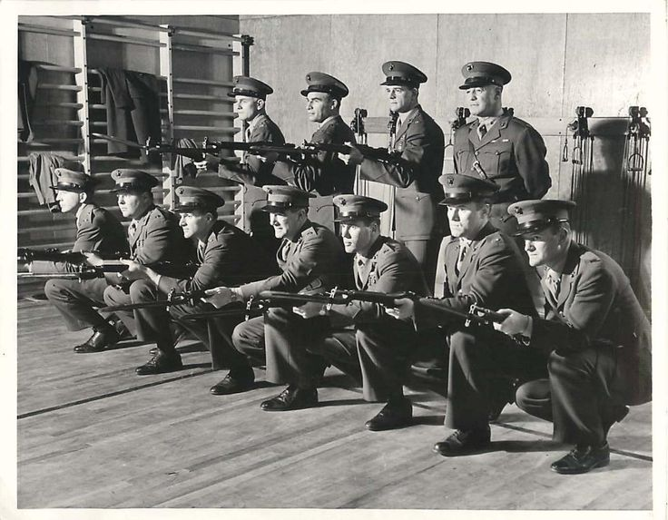 1942- Former football stars, now in the Marines and being trained for combat at Navy Pier, Chicago, form this team rounded out by Maj. Dick Hanley (standing at right), former football coach at Northwestern. Kneeling, left to right: Sam Kuen (Penn), Walter Moeling (Penn), Ben Sohn (Southern California), Tim Moynihan (Notre Dame) Charles Camp (Dartmouth), Jack Riley (Northwestern). Standing, left to right: Lee Hanley (Northwestern), Dick Fishell (Syracuse) and Francis Reagan (Penn).