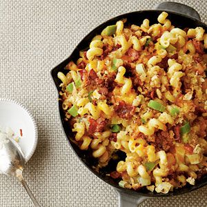 Hugh Acheson's Southern Mac and Cheese combines 2-year-old aged Cheddar cheese with Gruyere cheese, diced bacon, and  leeks. The results are a deliciously baked Southern classic that's finished with a drizzle of heavy cream and toasted breadcrumbs.