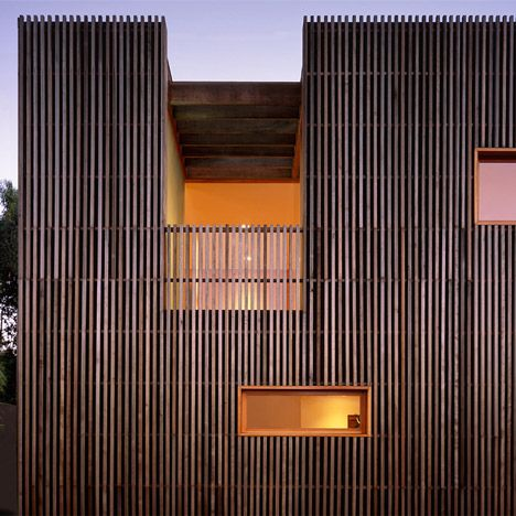 Narrow batons of red cedar clad the two-storey house, which was designed by American architects Casey Hughes.