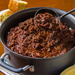 Classic Chili Con Carne With Ancho Chile Pepper, Cumin Seed, Mexican Oregano, Garlic Powder, Cumin Seed, Bacon, Boneless Beef Chuck, White Onion, Paprika, Mexican Oregano, Ground Black Pepper, Dried Thyme Leaves, Salt, Large Garlic Cloves, Beef Broth, Tomatoes, Ancho Chile Pepper